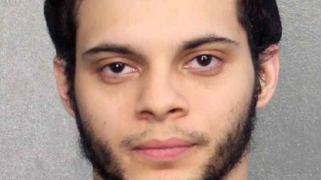 Airport shooter pleads guilty of killing 5