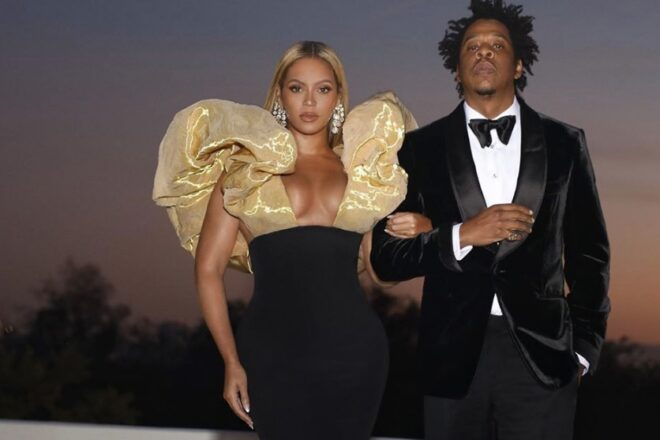 Rapper Jay-Z and Beyonce sit during National Anthem